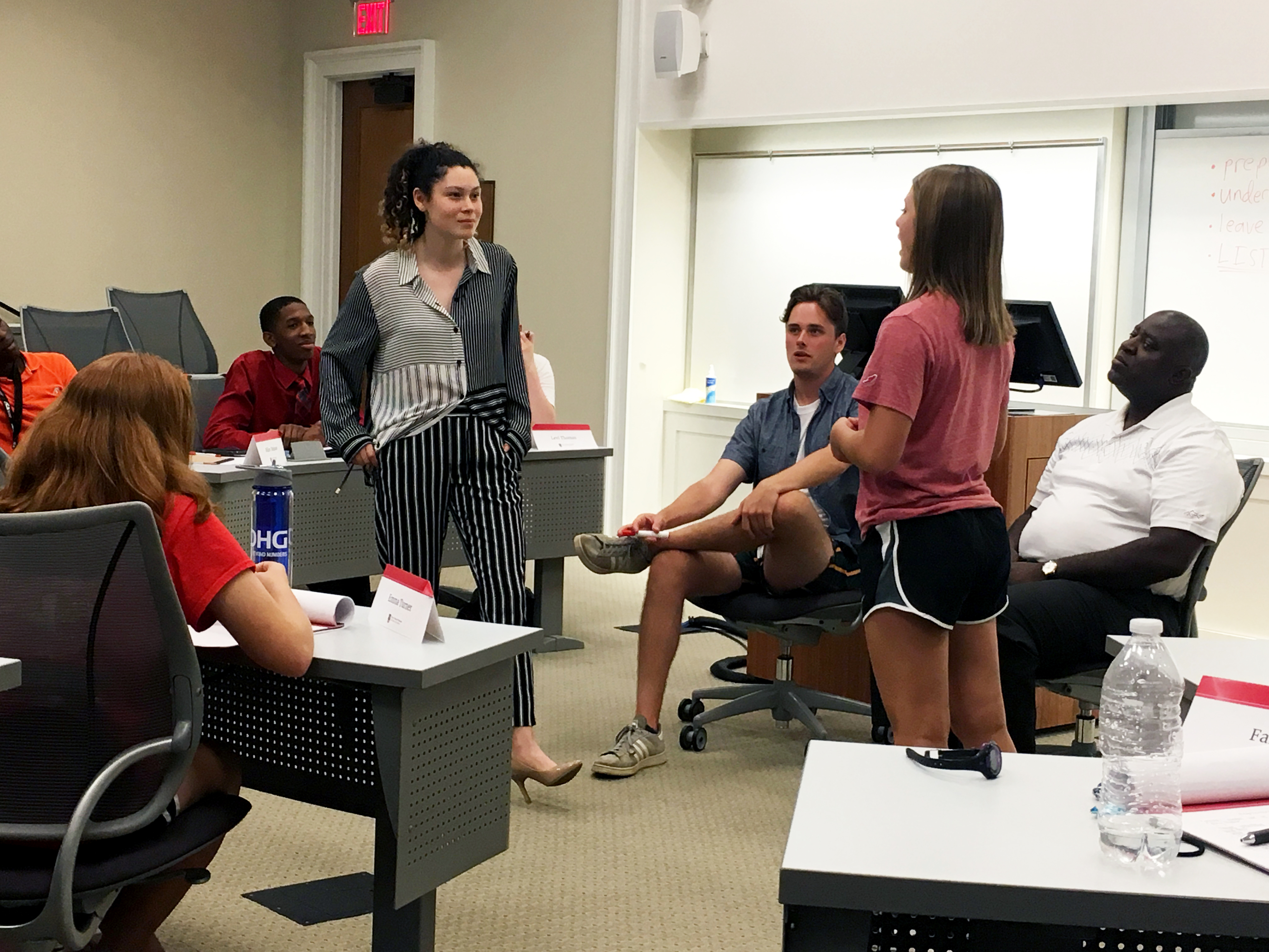 (L-R) High school students Alexis Smith and Faith Wagner put their skills to the test in a mock negotiation during the Terry Business Academy.