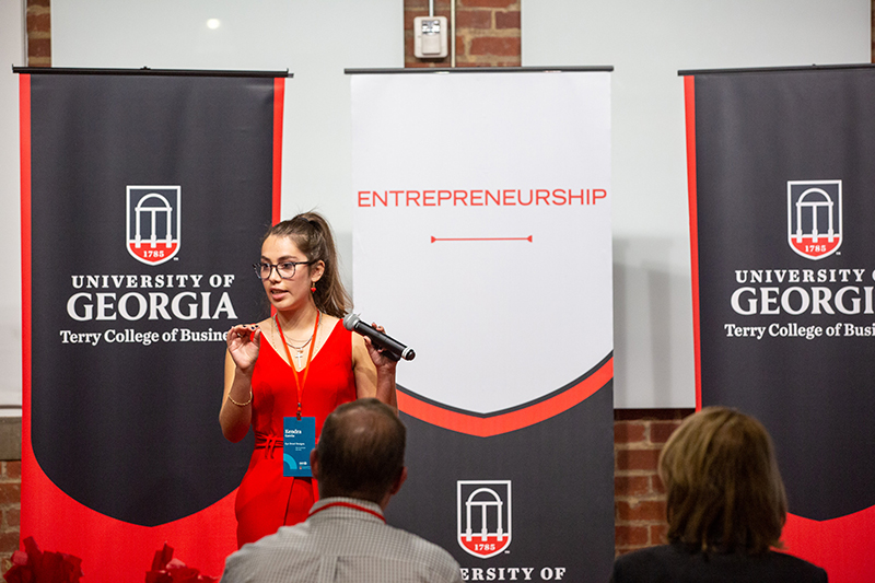 Kendra Garcia, founder of Eye Drool Designs and a student in UGA's College of Engineering, pitches her company to a panel of judges during the UGA Idea Accelerator Demo Day pitch competition at Studio 225 on Nov. 11. Garcia and her company won the $5,000 top prize. Photo by Matt Hardy