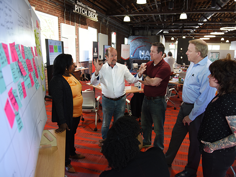 David Sutherland, center, leads a class in human-centered design thinking at Studio 225.