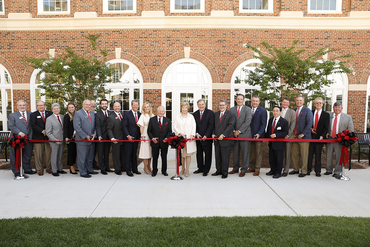 Beginning ninth from left, cutting the ceremonial ribbon were Georgia Gov. Brian Kemp and his wife, Marty; Sanford Orkin; Kay and Doug Ivester; President Jere W. Morehead; and Terry College Dean Ben Ayers. (Andrew Davis Tucker/UGA)
