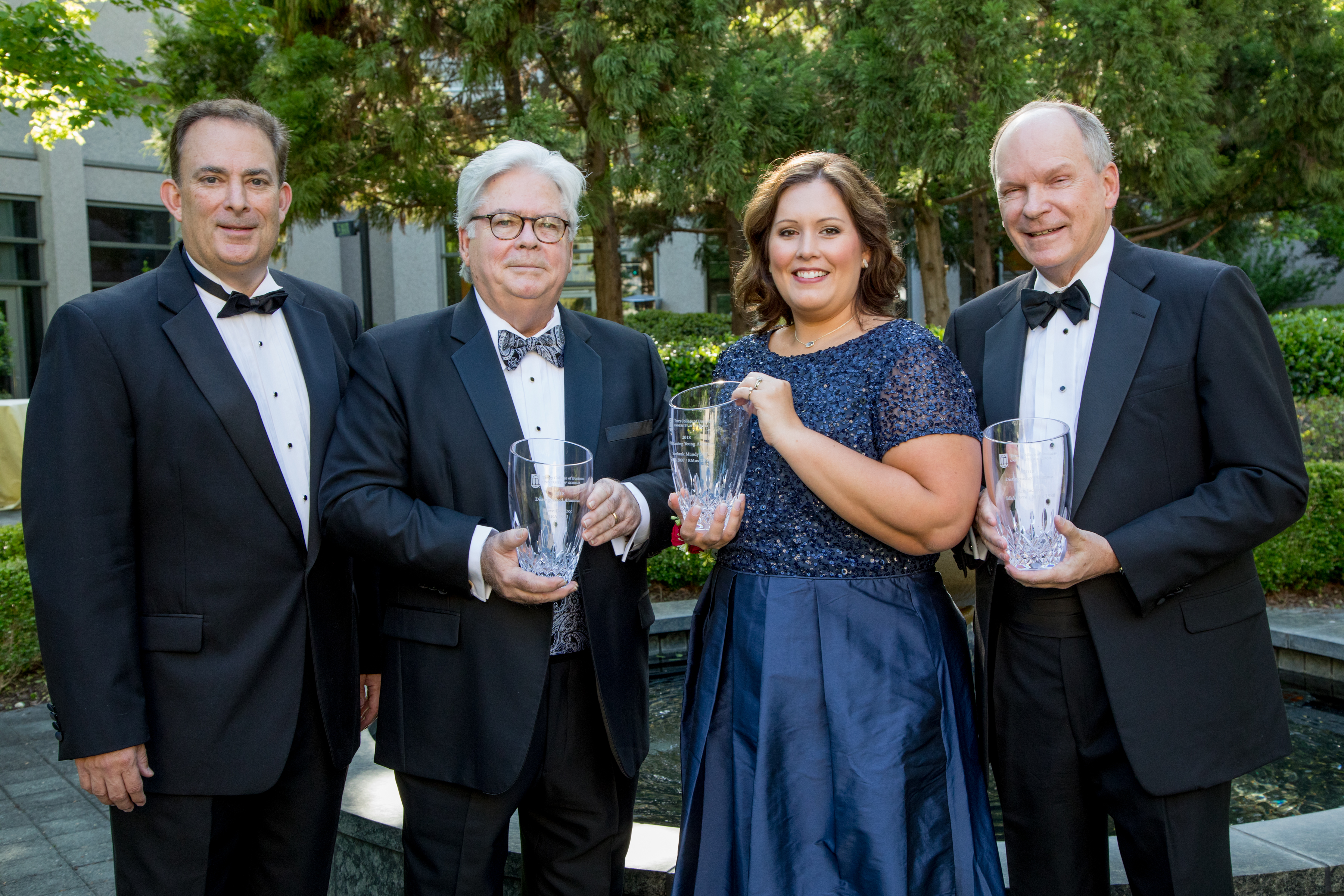 From left: Dean Benjamin C. Ayers stands with award recipients Steve Goodroe, Stephanie Mundy Self and Ken Jackson.