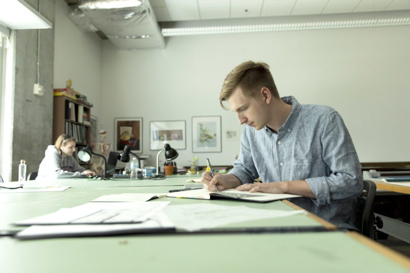 Jackson Mitchell is learning hand drafting, watercolor, AutoCAD, design process, universal design and site and space planning in his interior design classes in the Lamar Dodd School of Art. (Photo by Andrew Davis Tucker/UGA.)