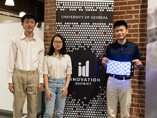 Barnabas Li, from left, Michelle Li, and TJ Lu won the $1,000 first prize at the UGA Quick Pitch contest on Sept. 8 at the UGA Innovation Hub.