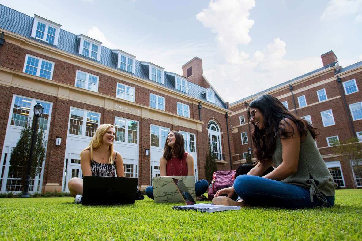 Elizabeth Doherty (from left), Melissa Crane and Alina Taher talk and study in the BLC courtyard.