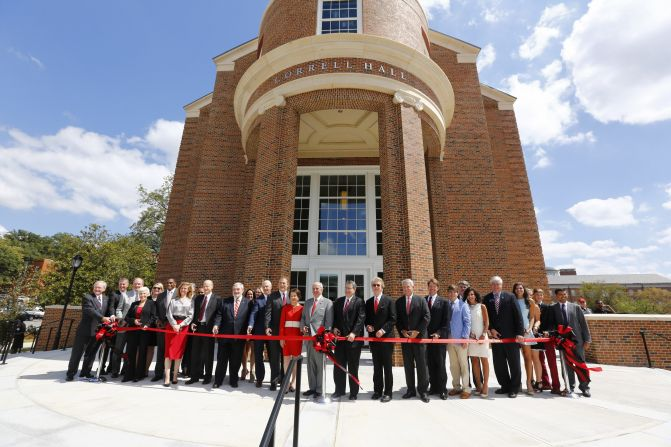 Ceremony also breaks ground on Amos Hall, centerpiece of Phase II